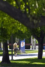 Female student walking through the center of campus