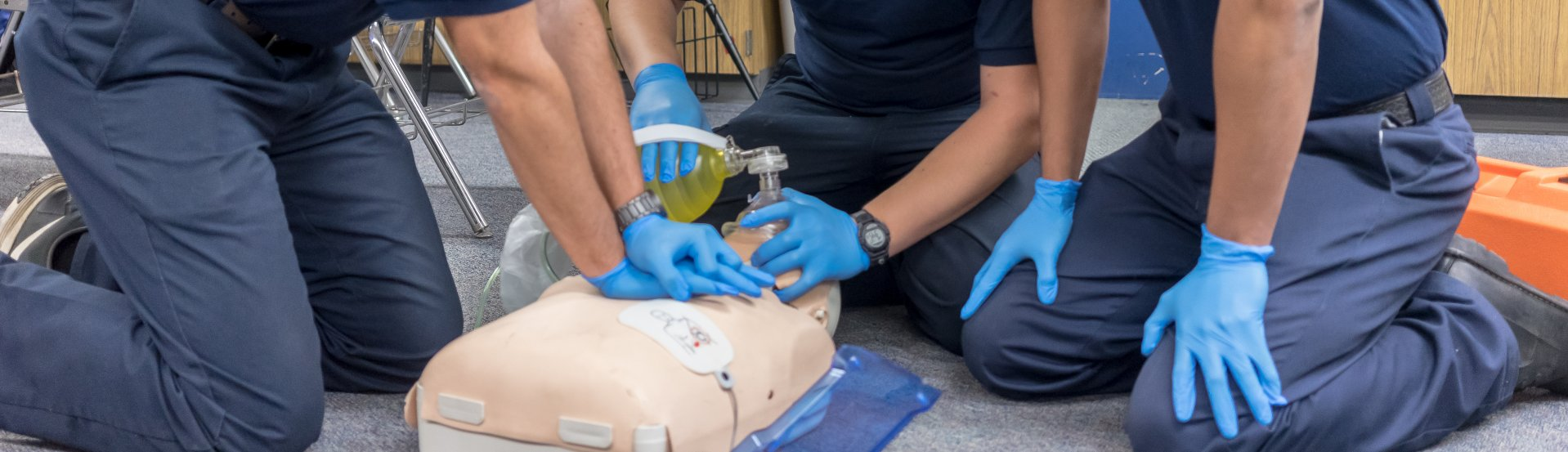 EMT students practicing resuscitation on a dummy