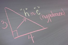 Geometry formula and triangle on chalkboard
