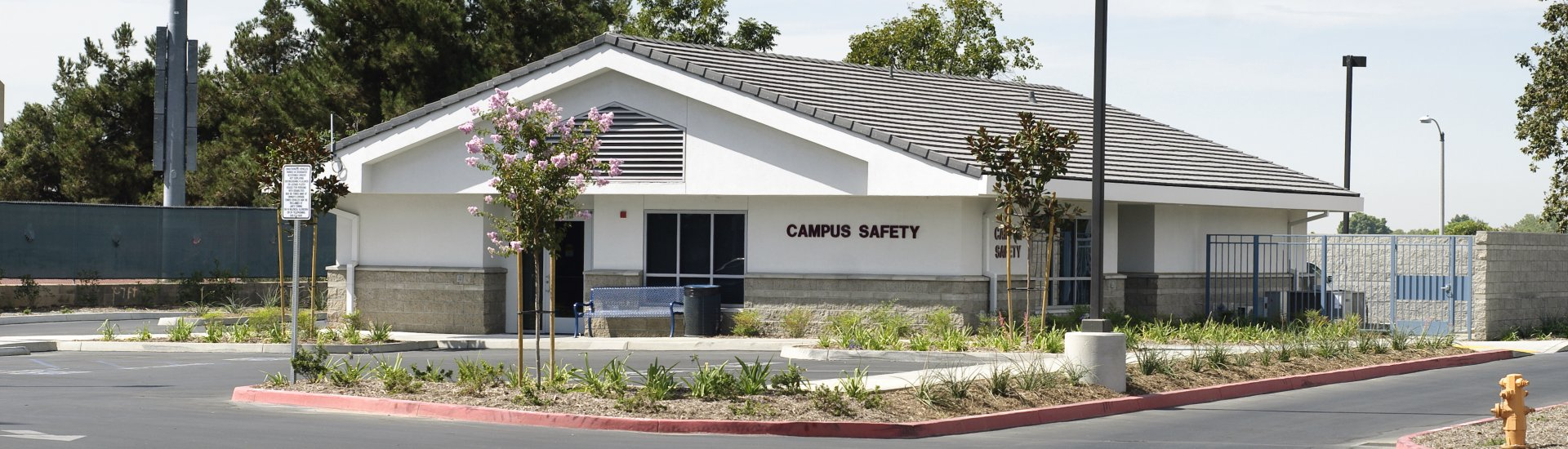 Campus Safety building located at the entry of the main parking lot at Citrus Avenue and Foothill Blvd.