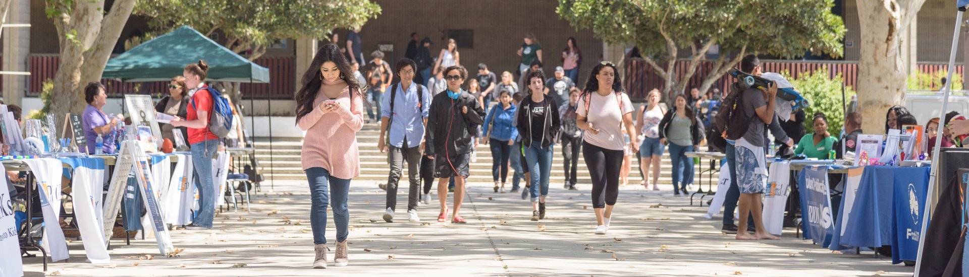 students walking down the Campus Center Mall from the Lecture Hall